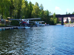 Two seaplanes docked at marina Stock Footage