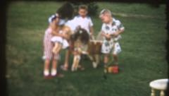 Vintage home movies ,wheelbarrow kids Stock Footage