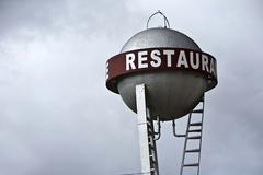 Water tank with indication written in red restaurant, spain Stock Photos