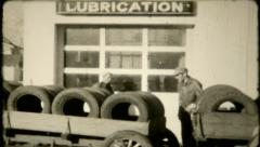 621 - tire delivery to local service station - vintage film home movie Stock Footage