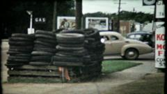 644 - Texaco tire recycling center at gas station - vintage film home movie Stock Footage