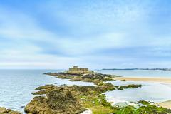 Saint malo fort national and rocks, low tide. brittany, france. Stock Photos