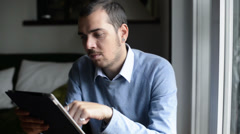 Young elegant man multitasking using notebook, cellphone and tablet Stock Footage