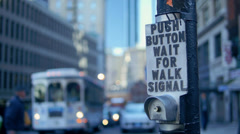 Boston Crosswalk Button with Trolly, Traffic and Pedestrians in Bokeh - stock footage