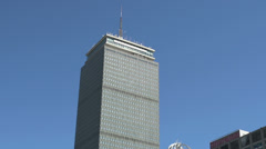 Prudential Tower in downtown Boston tilt to street Stock Footage