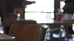 People leaving cafeteria focus on chair Stock Footage