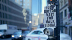 Hand Pushes Boston Crosswalk Button with Traffic and Pedestrians in Bokeh Stock Footage