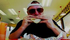 Man Eating Burrito At Fast Food Restaurant Stock Footage