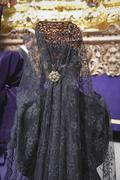 Woman dressed in mantilla during a procession of holy week, spain Stock Photos