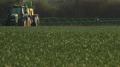 Farmer spraying pesticides in spring time Stock Footage