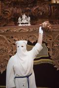 nazarene that goes with the hand on the manigueta the throne in a procession  - stock photo