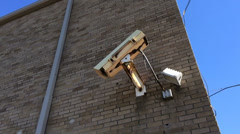 Side of building with large security camera 720p Stock Footage