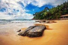 Tropical beach under gloomy sky Stock Photos