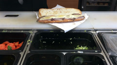 Sub sandwich made at restaurant Stock Footage