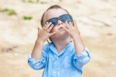 portrait of child with sunglasses - stock photo