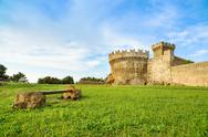 Stock Photo of populonia medieval village landmark, bench, city walls and tower. tuscany, it