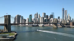 New York City Brooklyn Bridge and downtown building skyline Stock Footage