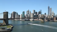 Stock Video Footage of New York City Brooklyn Bridge and downtown building skyline