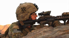 U.S. infantry soldier looking through sights of his rifle Stock Footage