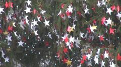 Christmas tree decoration ornamental public town city urban public holidays fun Stock Footage