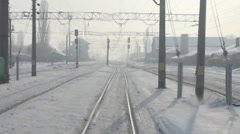 POV, point of view train passing moving rail road tracks winter time snow day Stock Footage