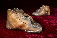 antique vronzed baby shoes - stock photo