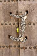 Door closed with chains, osuna, sevilla province, Andalusia, spain Stock Photos