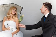 Stock Photo of romantic married couple bride and groom with rose
