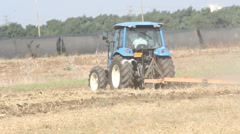 Agriculture farmer working tractor harvest machinery agronomy - stock footage