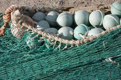 Fishing net at an old port, estepona, malaga province, spain Stock Photos
