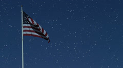 American flag in early evening while snowing Stock Footage