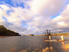 Dam on the background of clouds. Time Lapse. 4x3 Stock Footage