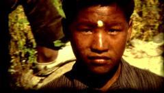 Indiana Nepal colcher Kathmandu young boy poverty vintage historic Stock Footage