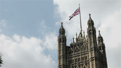 UK flag on top of the Houses of Parliament, London, UK Stock Footage