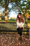 woman sitting on bench - stock photo