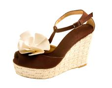 Wedge raffia peep toe sandal with fabric rose Stock Photos