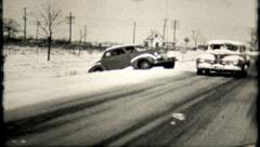 Car spins off the road in dangerous snowy conditions,661 vintage film home movie Stock Footage