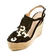 Raffia wedged fringed flip flop sandals with the word chic Stock Photos