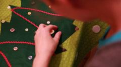 a woman creating christmas advent calendar - stock footage