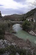 Stock Photo of Roman bridge over the passage of colomera river, near the village