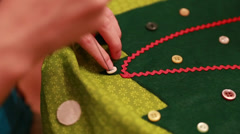a female sewing a christmas advent calendar - stock footage