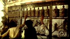 Culture colcher Nepal Kathmandu prayer wheels buddhist temple vintage historic Stock Footage
