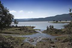 panoramic view of the puente nuevo reservoir at full capacity, municipality o - stock photo
