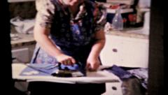Laundry day continues with the ironing, 662 vintage film home movie Stock Footage