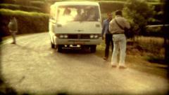 Culture Nepal colcher Kathmandu van road people standing vintage old film Stock Footage