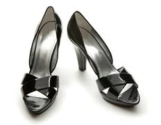 Black patent leather elegant peep toe pumps Stock Photos