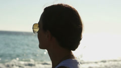 Silhouette profile of a woman looking at the sea HD - stock footage