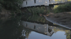 Covered Bridge reflection pan Stock Footage