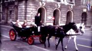 Stock Video Footage of 8mm old film Vienna, Austria horse and carriage Hofburg Palace