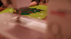 a female hand sewing a christmas advent calendar - stock footage